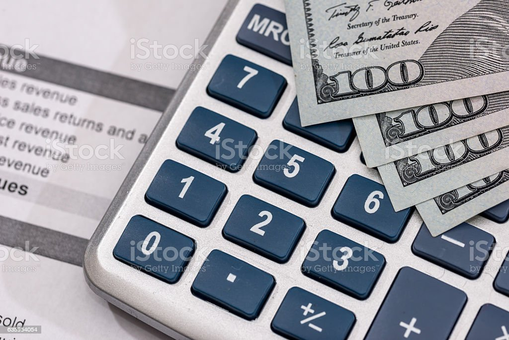 Save money concept - utility bill with pen, calculator and stock photo