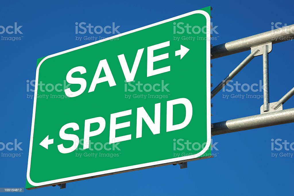 Save or Spend Highway Sign royalty-free stock photo