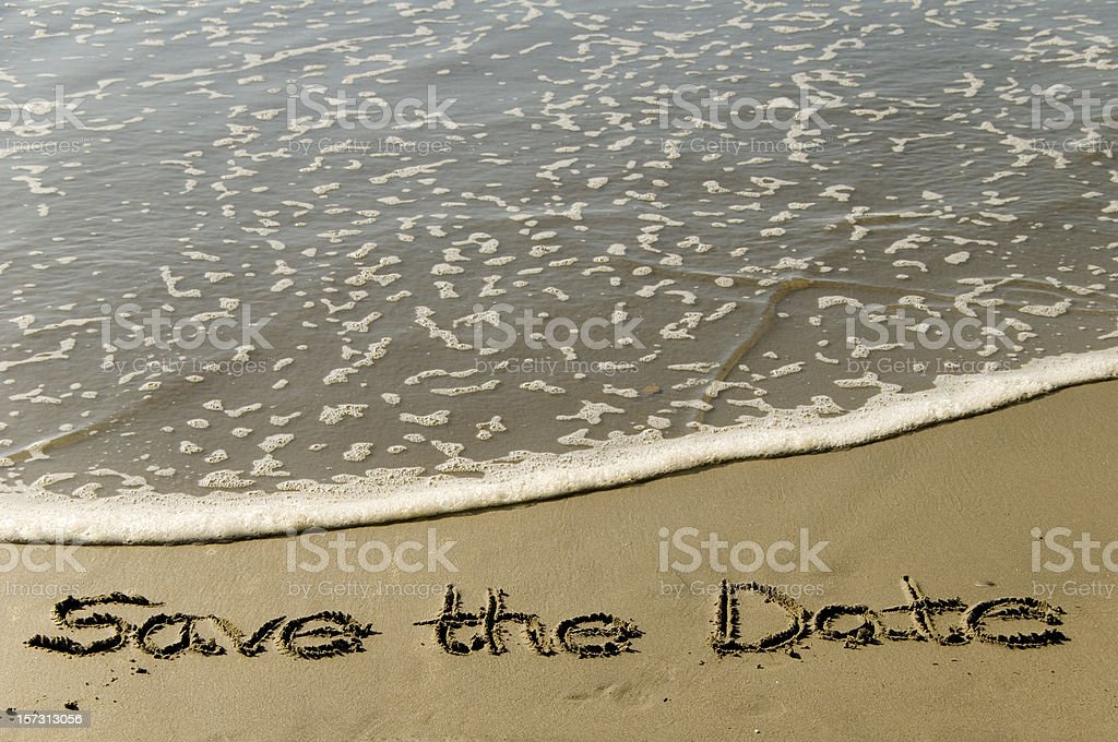 Save the date in sand stock photo