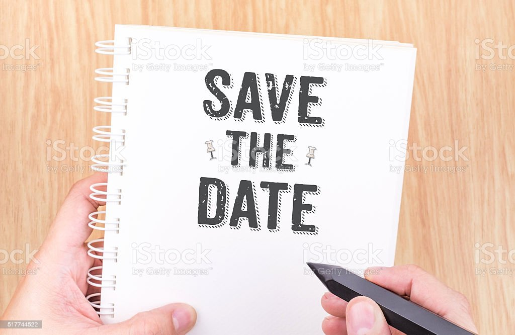 Save the date on white ring binder notebook with hand stock photo