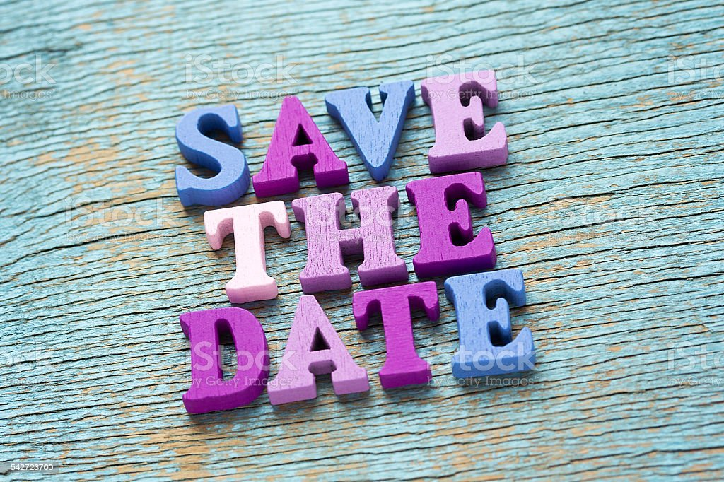 Save the date phrase on vintage wooden background stock photo