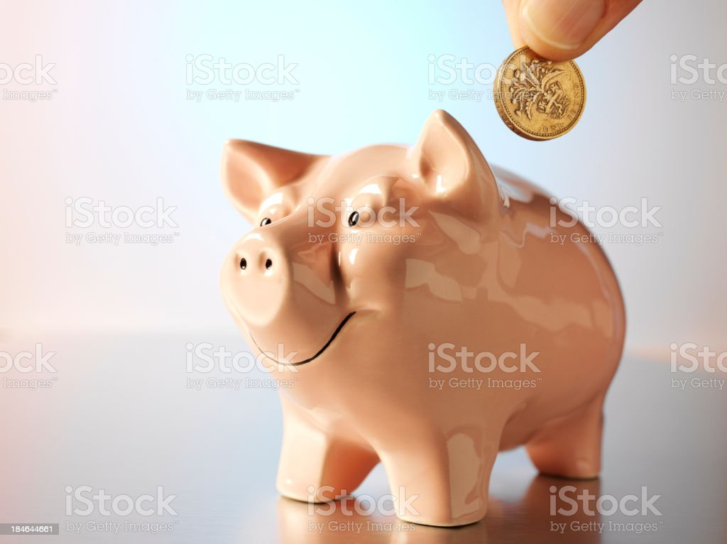 Saving a British Pound royalty-free stock photo