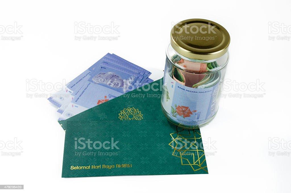 Saving Duit Raya stock photo