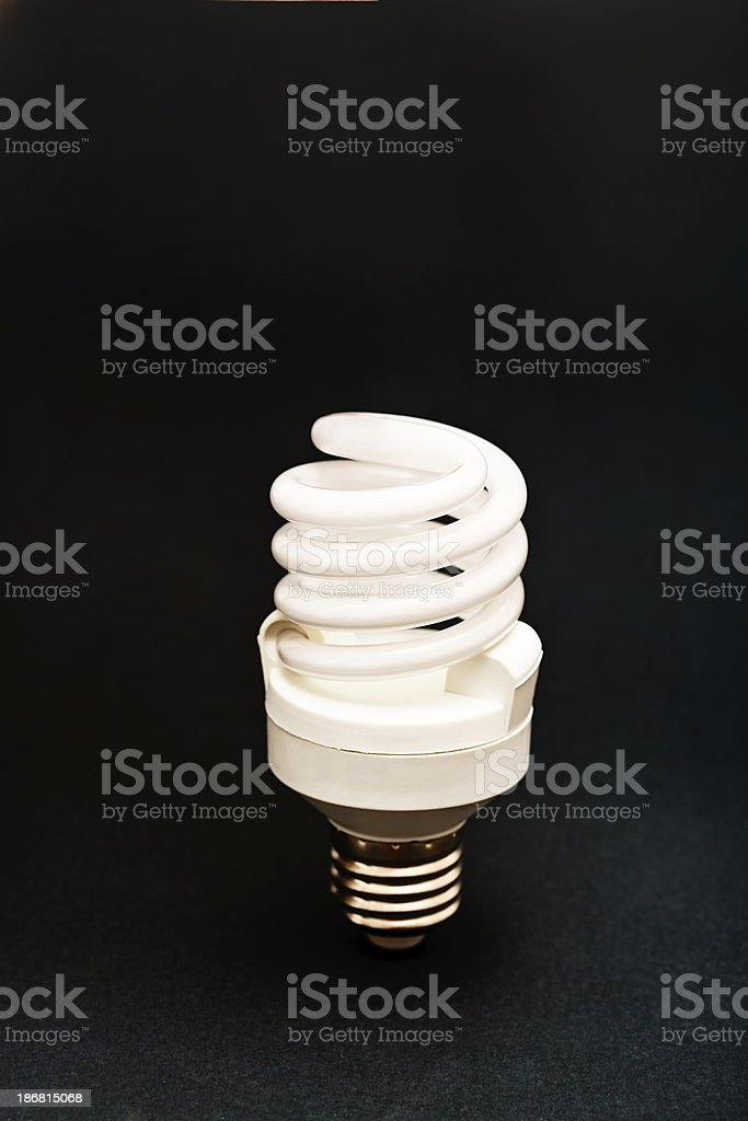 Saving energy, the environment, and money: a compact fluorescent lightbulb stock photo