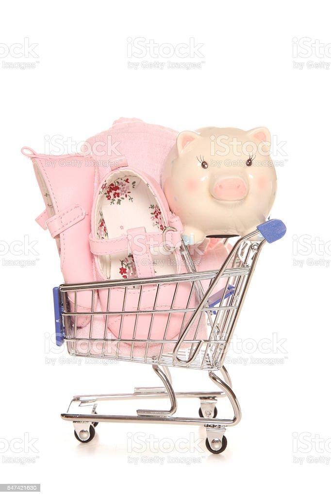Saving for a baby girl piggybank stock photo