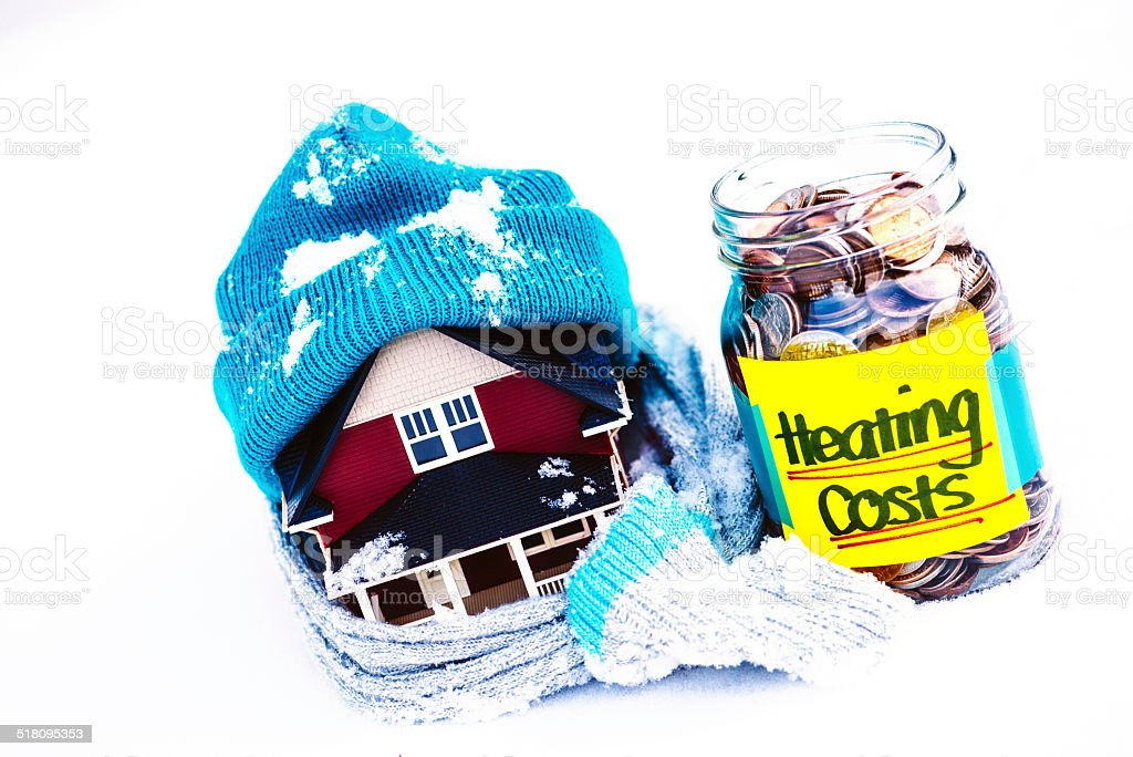Saving for Winter Heating Costs stock photo