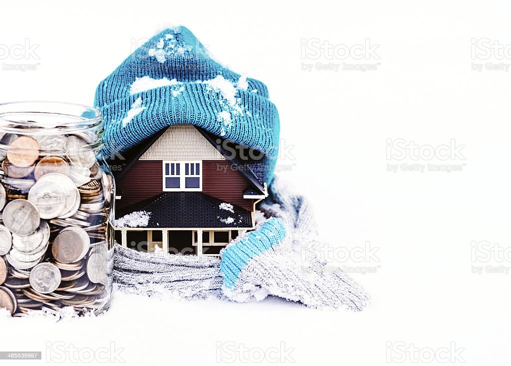 Saving for Winter Housing Costs royalty-free stock photo