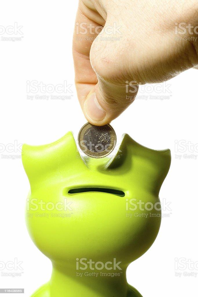 Saving in a green biggy bank stock photo