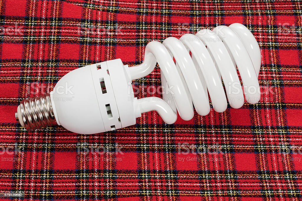 Saving lamp on red cloth stock photo