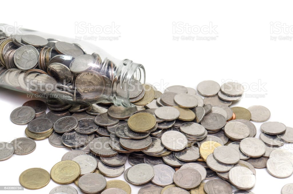 Saving money concept of collecting coins in glass bottle Isolated. stock photo