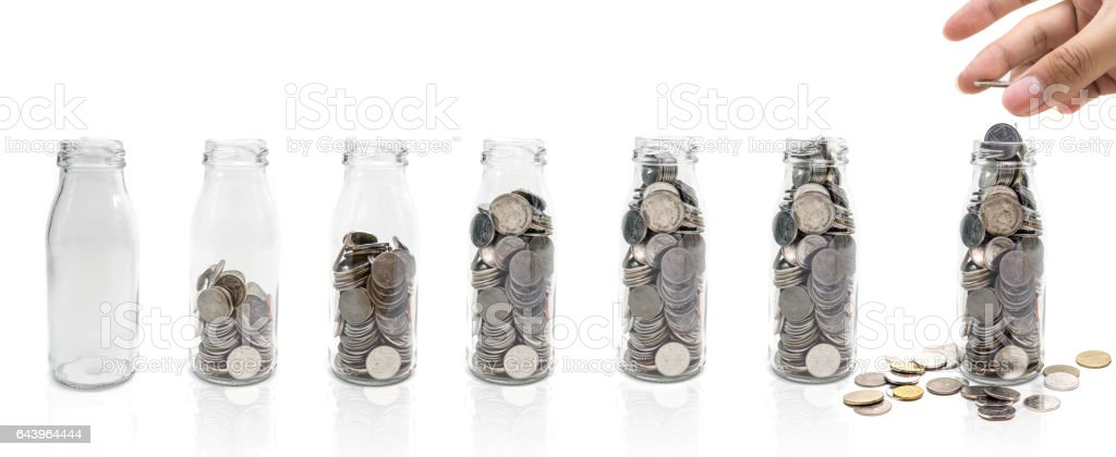 Saving money concept of collecting coins in glass bottle. stock photo