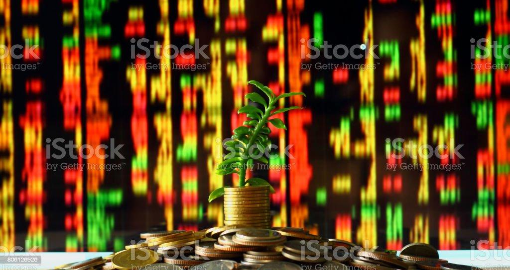 Saving money concept with blur of Stock market stock photo