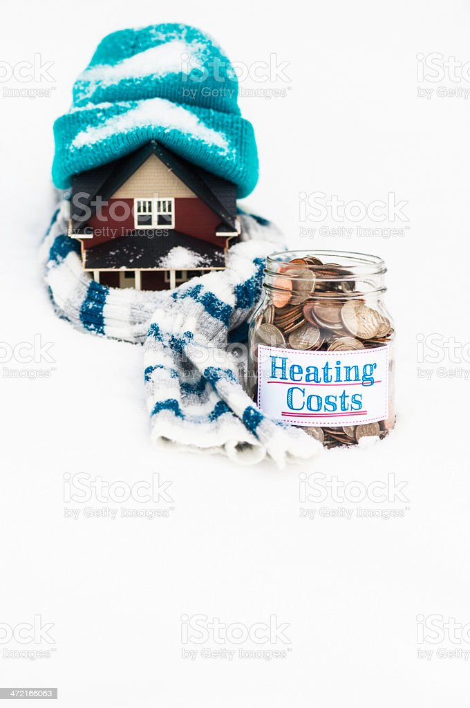 Saving Money for Heating Costs stock photo