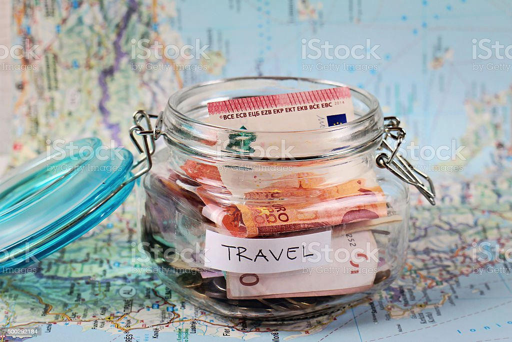 Saving money for travel, planning holiday or vacation royalty-free stock photo