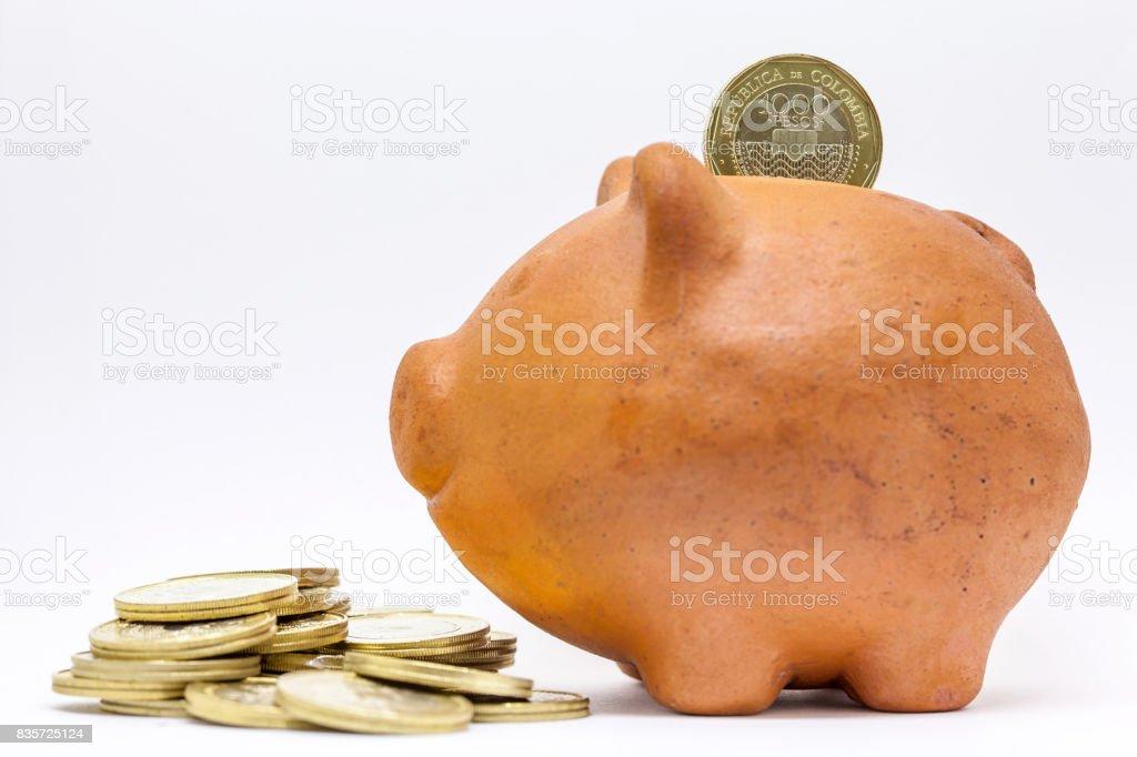 Saving money in a piggy bank stock photo
