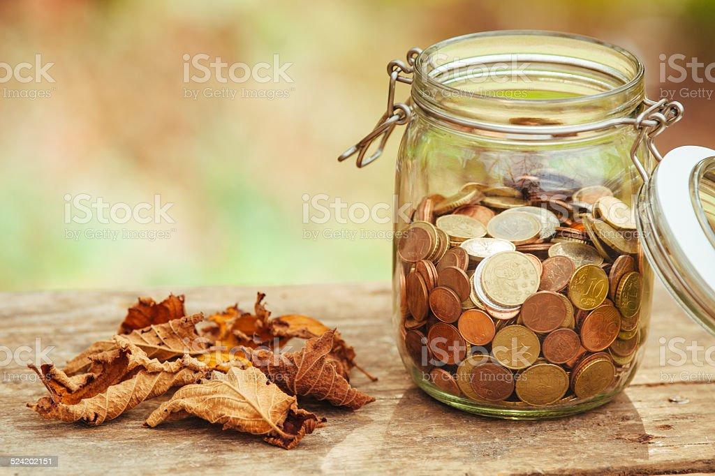 Saving money jar stock photo