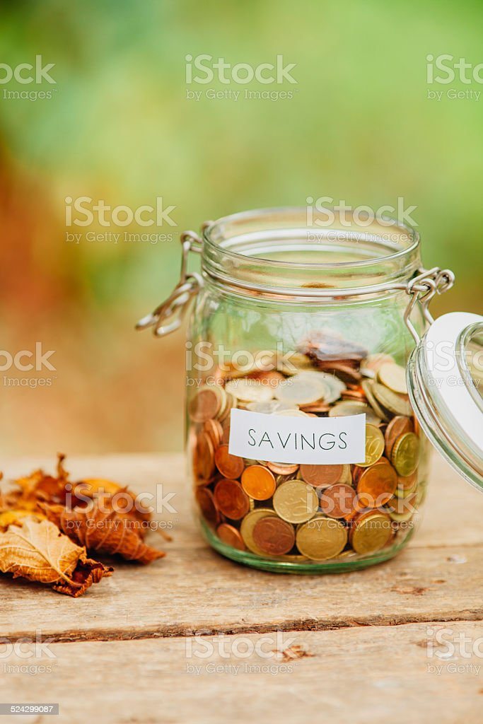 Saving money jar stock photo