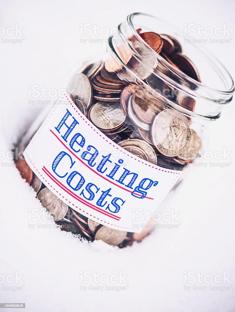 Saving money to pay heating bills stock photo