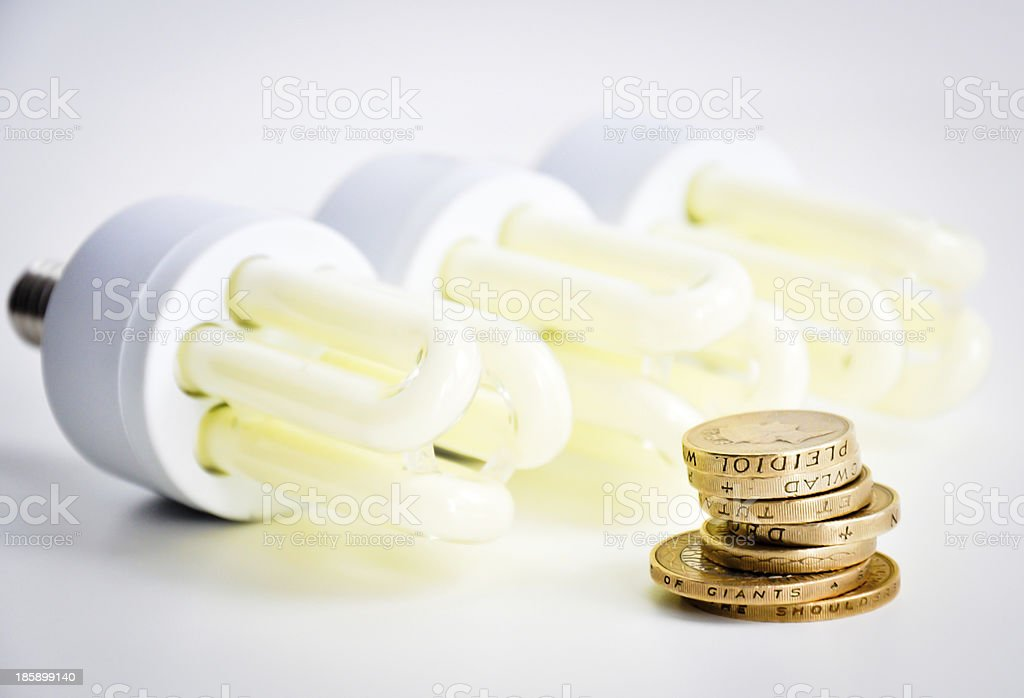 saving money with economical bulbs stock photo