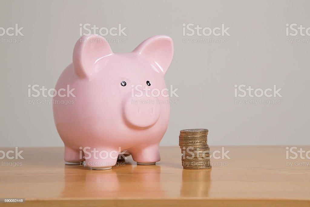 Saving up using a piggy bank stock photo