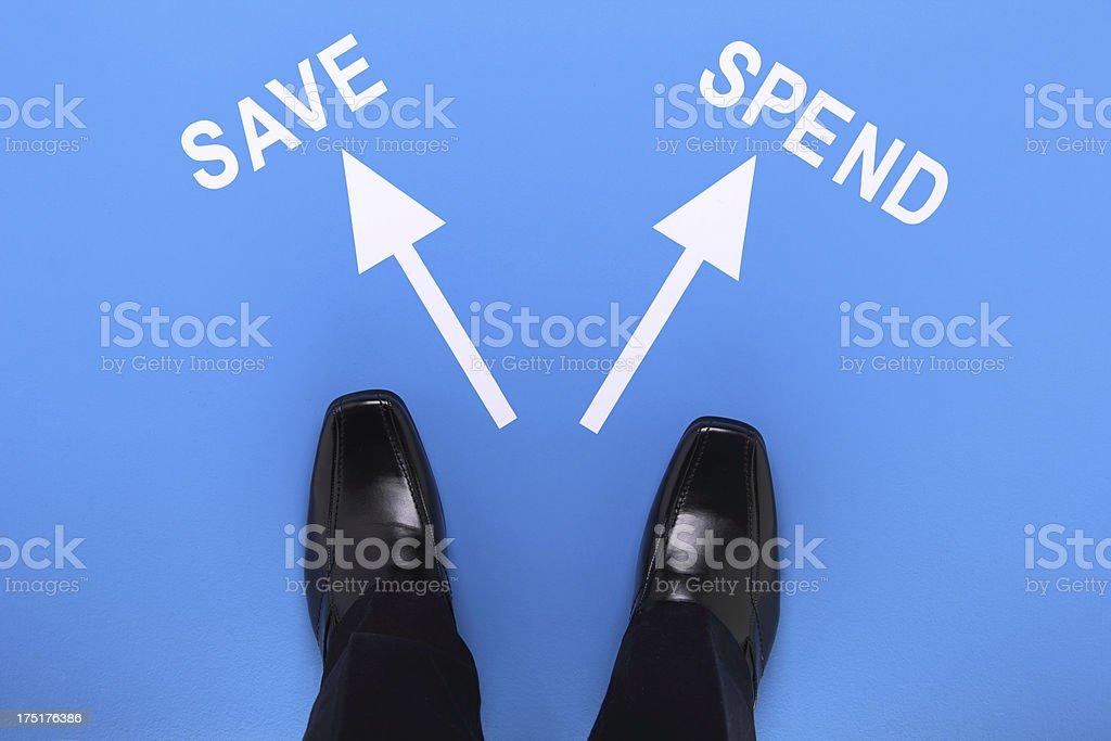 Saving Vs Spending royalty-free stock photo