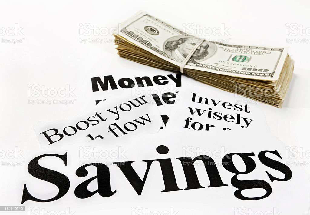 Savings and money-related headlines with bundle of US dollars royalty-free stock photo