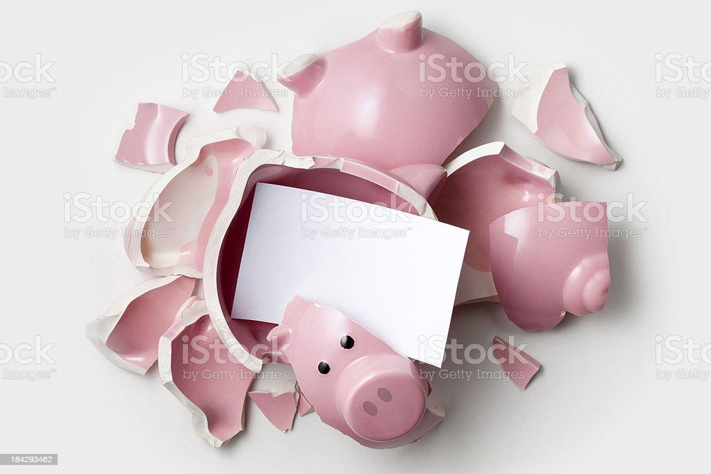 Savings. Broken piggy bank with blank note. stock photo