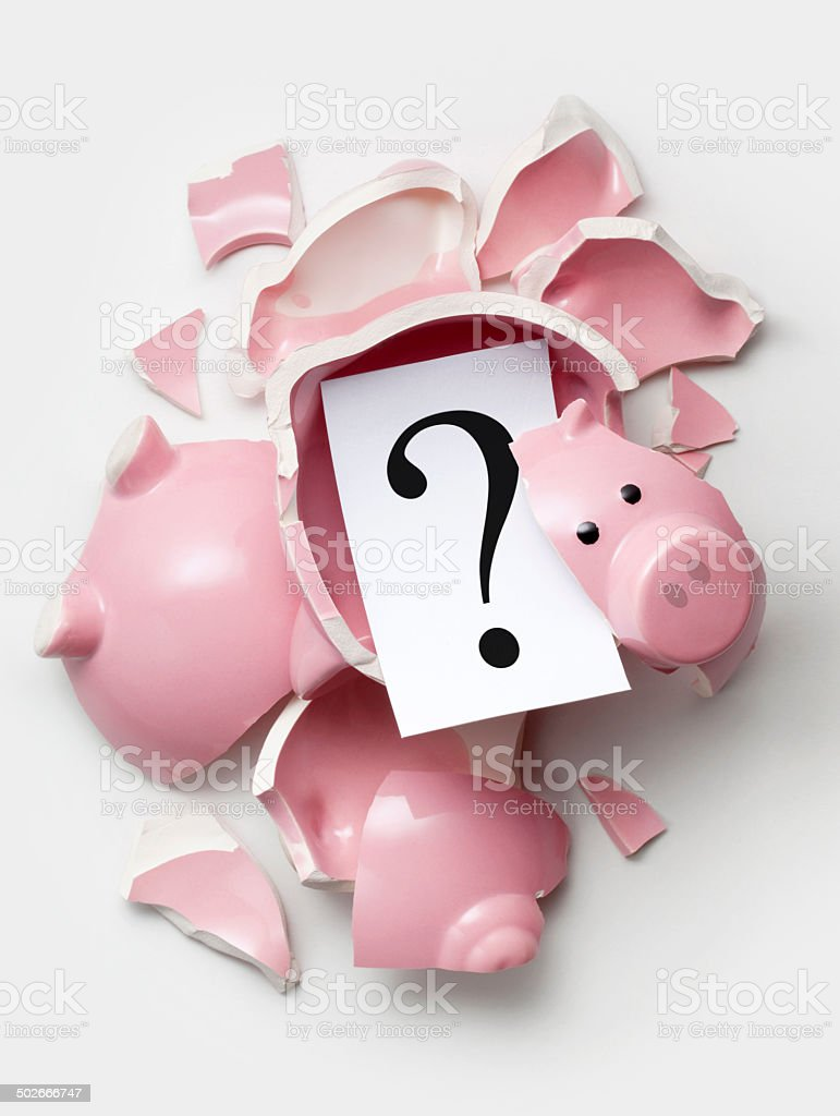 Savings. Broken piggy bank with question mark. stock photo