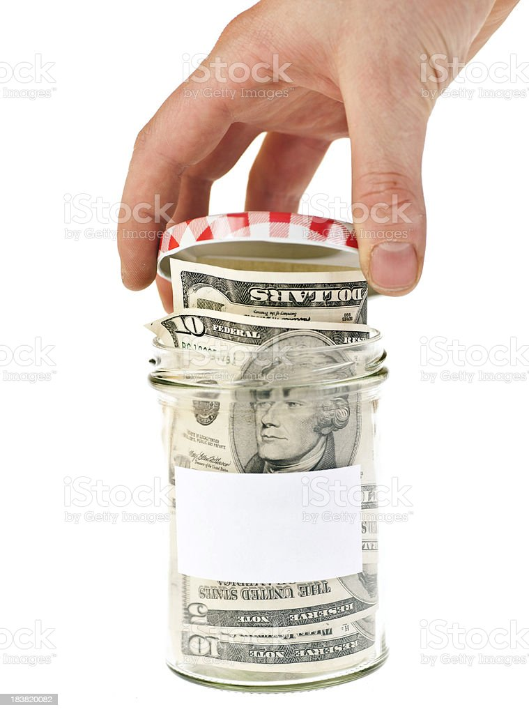 savings in jar with hand royalty-free stock photo