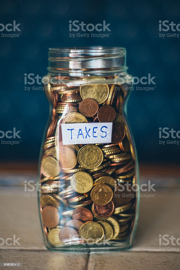 Savings jar for Taxes stock photo