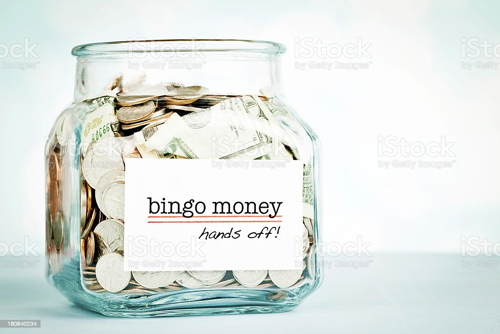 Savings Jar with Bingo Money royalty-free stock photo