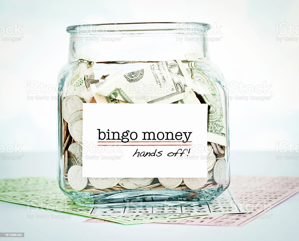 Savings Jar with Bingo Money stock photo