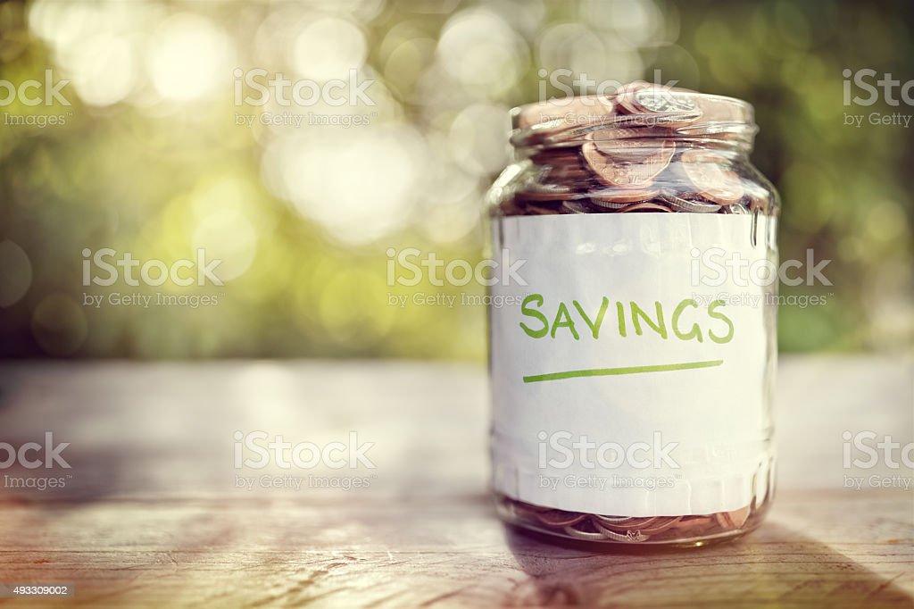 Savings money jar stock photo