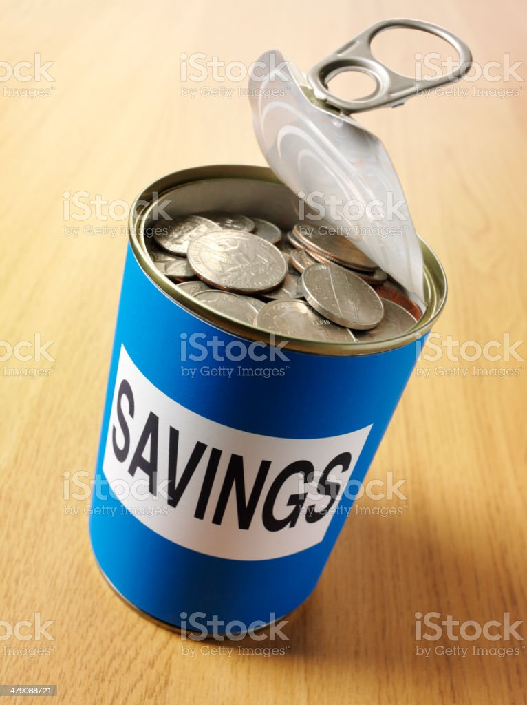 Savings on a Tn Can on the Wooden Desk royalty-free stock photo