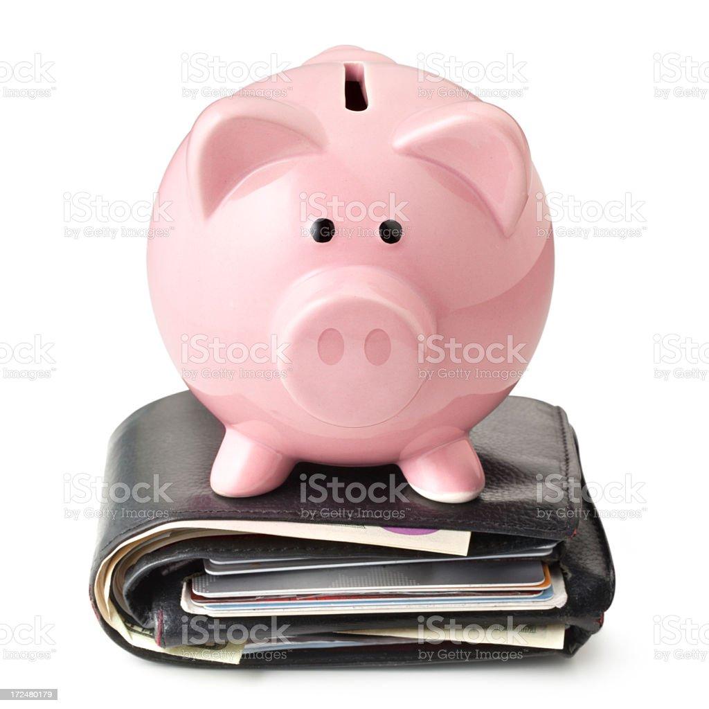 Savings. Piggy bank on wallet. royalty-free stock photo