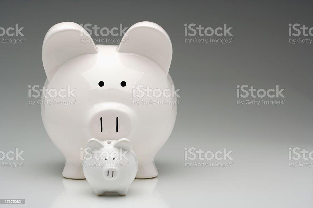 Savings...start small but think BIG! Piggy Banks royalty-free stock photo
