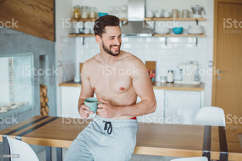 Savoring his morning coffee stock photo