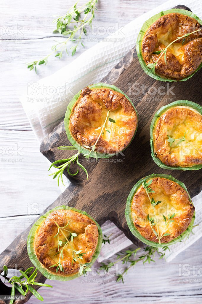 Savory cheddar cheese and leek mini quiches stock photo