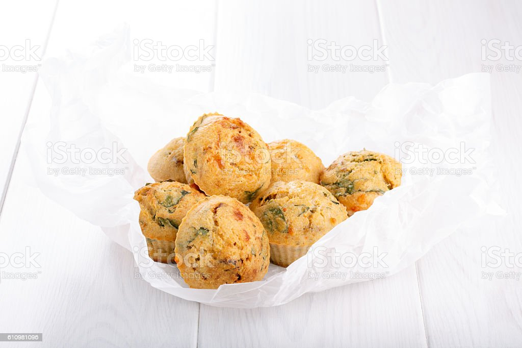 Savory cheese maffins with basil and sun-dried tomato stock photo