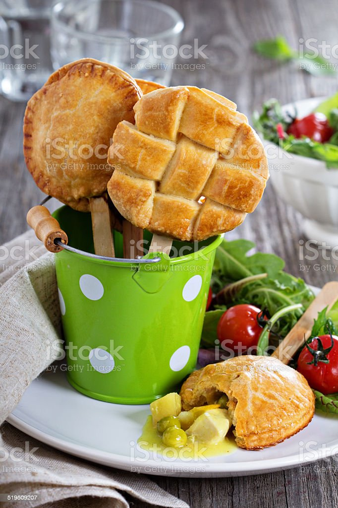 Savory hand pies with chicken stock photo