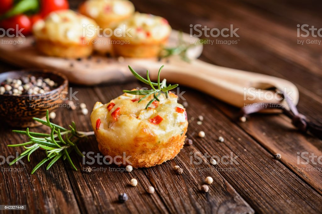 Savory muffins with Feta cheese, curd, pepper and herbs stock photo