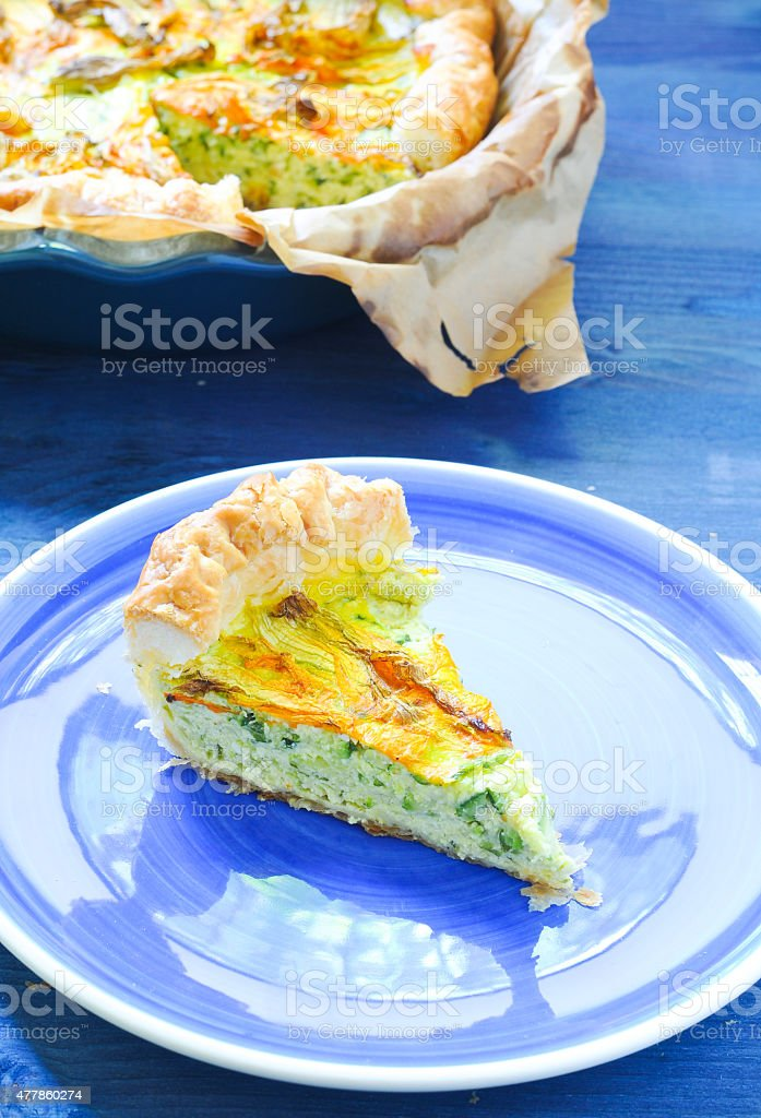 Savory pie with ricotta, parmesan and zucchini flowers stock photo
