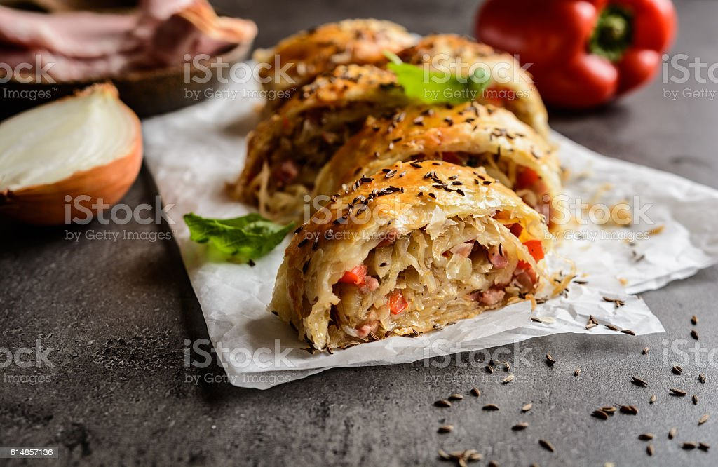 Savory strudel with sour cabbage, bacon and onion stock photo