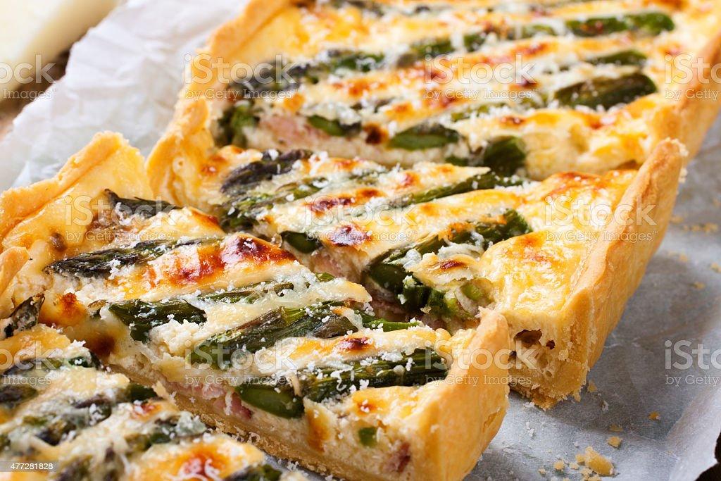 Savory tart with pecorino and bacon stock photo