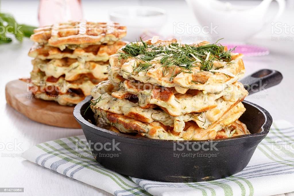 Savory vegetable waffles with cheese and herbs stock photo