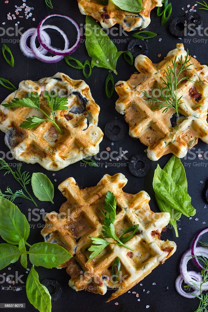 savory waffles with cheese, ham, olives and herbs stock photo