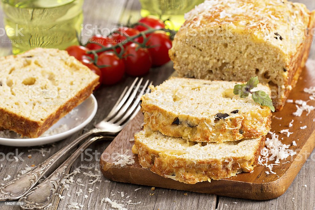 Savoury loaf cake with tomatoes, cheese and olives stock photo