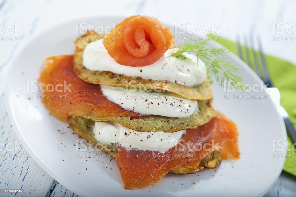 Savoury pancake with salmon and yoghurt royalty-free stock photo