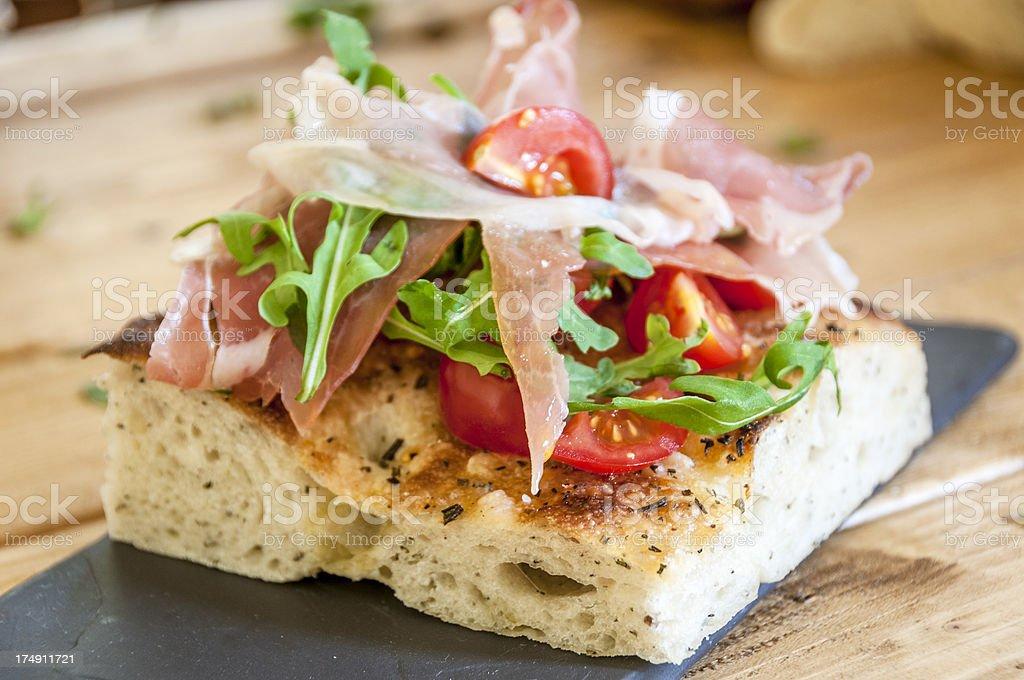 Savoury Slice With Ham, Tomato And Rocket royalty-free stock photo