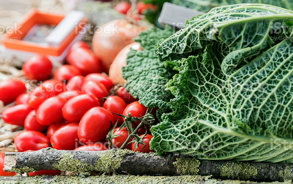 Savoy cabbage and cherry tomatoes stock photo